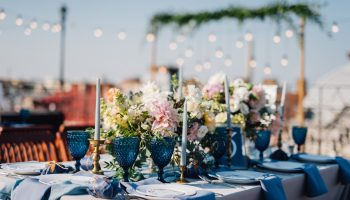 Long,Dinner,Tables,Covered,With,Grey,And,Blue,Cloth,,Served