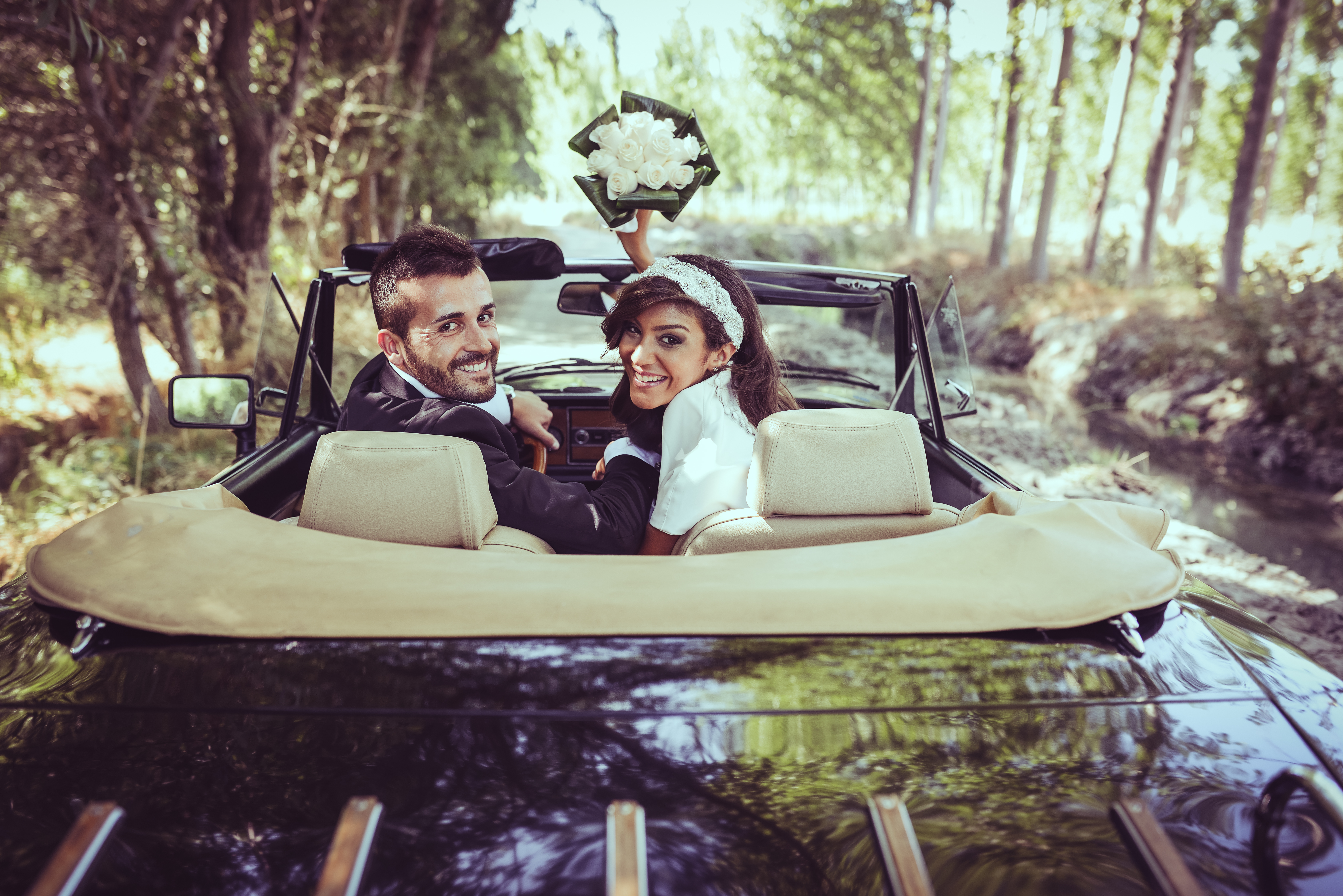Just,Married,Couple,Together,In,An,Old,Car