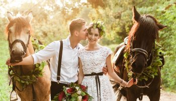 Bride,And,Groom,In,Forest,With,Horses.,Wedding,Couple,With
